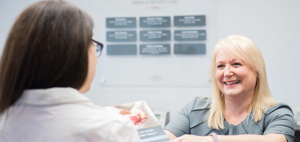 Walker Associates Dental Implant Clinic Reception With Patient