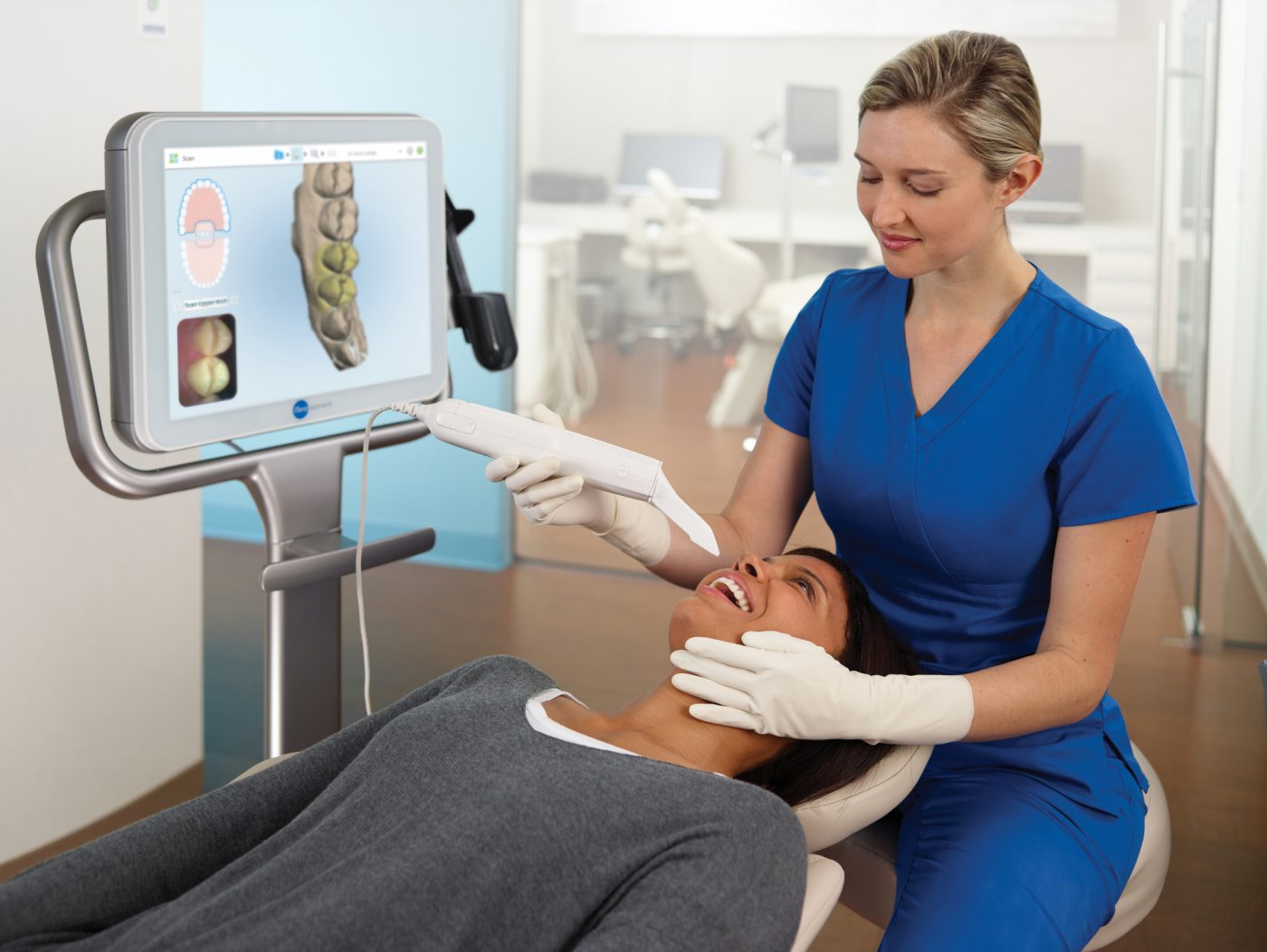 Assistant Scanning Patient