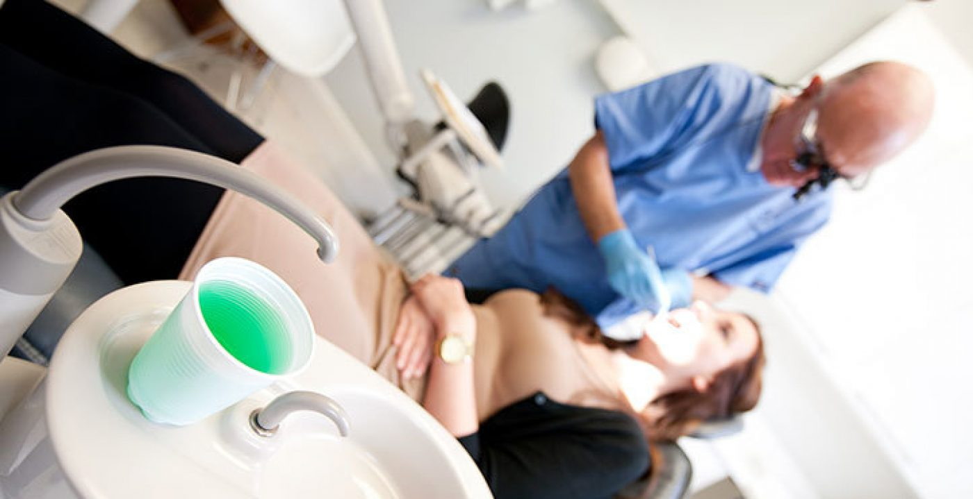 Dentist Treating Patient - Treatments - Portman Dental Care